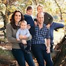 <p>Kate Middleton looked casual in this year's Cambridge Family christmas card. The duchess paired dark jeans with a grey sweater and collared button down. </p>