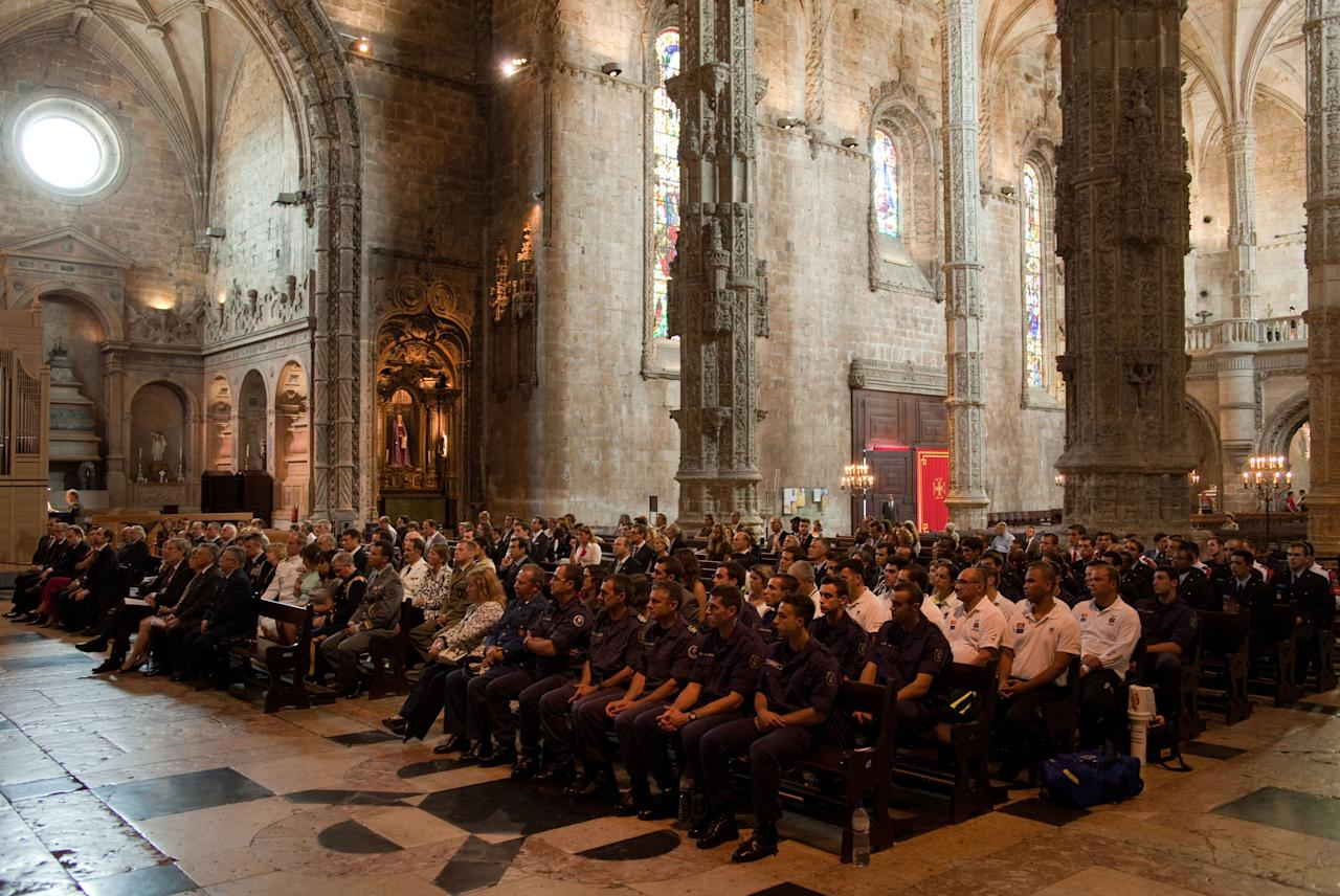 Portuguese firefighters, foreground, attend a mass Sunday, Sept. 11 2011, at Lisbon's 16th century Jeronimos Monastery to remember the victims  of the 2001 attacks on the World Trade Center in New York. (AP Photo/Armando Franca)