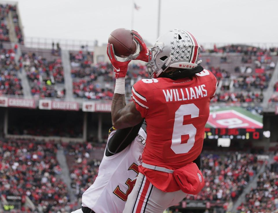 Ohio State Buckeyes wide receiver Jameson Williams (6) reels in a pass while defended by Maryland Terrapins defensive back Lavonte Gater (37) during the first half of Saturday's NCAA football game at Ohio Stadium in Columbus on November 9, 2019. [Barbara J. Perenic/Dispatch]