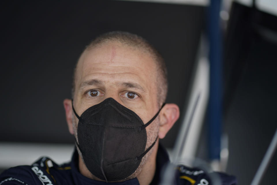Tony Kanaan, of Brazil, watches from his pit box during practice for the Indianapolis 500 auto race at Indianapolis Motor Speedway, Wednesday, May 19, 2021, in Indianapolis. (AP Photo/Darron Cummings)