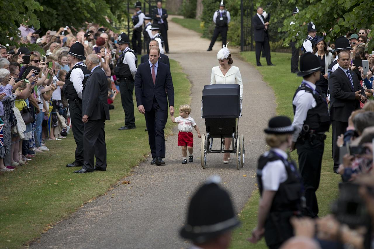 FILE - In this July 5, 2015 file photo, Britain's Prince William, Kate the Duchess of Cambridge, their son Prince George and daughter Princess Charlotte in a pram arrive for Charlotte's Christening at St. Mary Magdalene Church in Sandringham, England. Sandringham has served as a royal retreat for generations. (AP Photo/Matt Dunham, Pool, File)