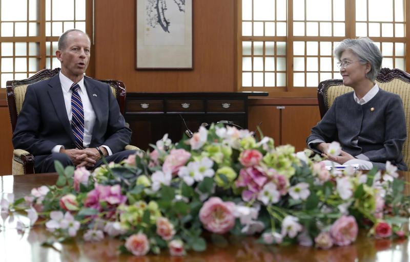 South Korean Foreign Minister Kang Kyung-wha, right, talks with David Stilwell, U.S. Assistant Secretary of State for the Bureau of East Asian and Pacific Affairs, during a meeting at the foreign ministry in Seoul, South Korea, Wednesday, July 17, 2019. (AP Photo/Ahn Young-joon. Pool)