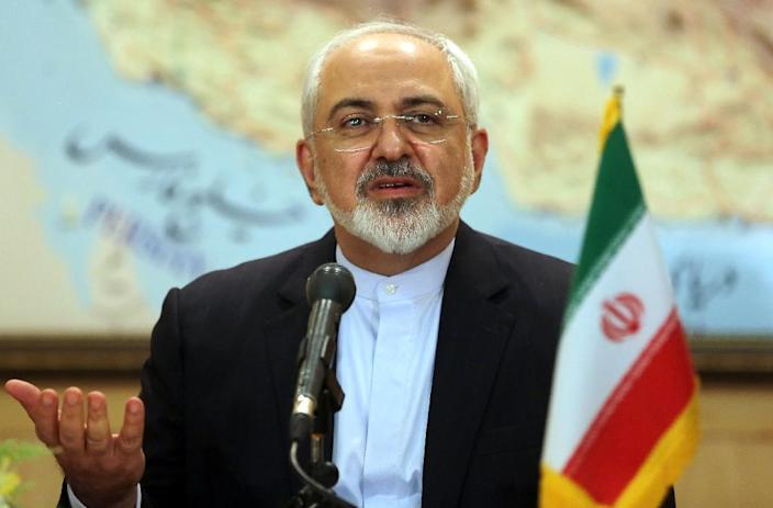 Iranian Foreign Minister Mohammad Javad Zarif speaks during a press conference at Tehran's Mehrabad Airport on July 15, 2015, after Iran's nuclear negotiating team struck a deal with world powers in Vienna (AFP Photo/Atta Kenare)