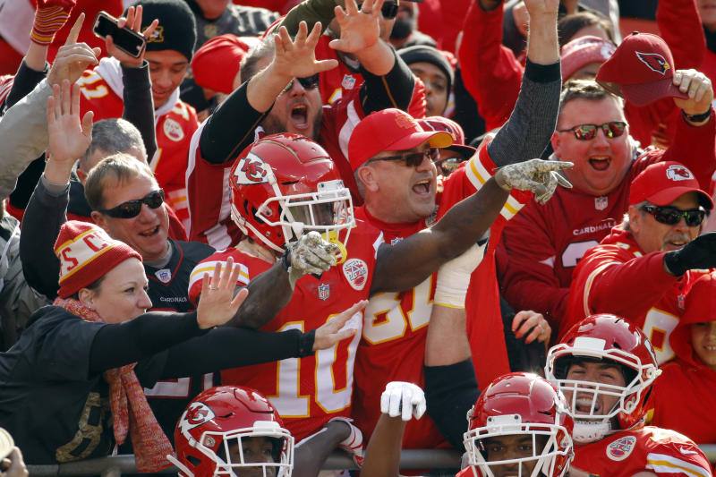 Kansas City Chiefs wide receiver Tyreek Hill (10) celebrates a touchdown against the Arizona Cardinals with fans during the first half of an NFL football game in Kansas City, Mo., Sunday, Nov. 11, 2018. (AP Photo/Charlie Riedel)