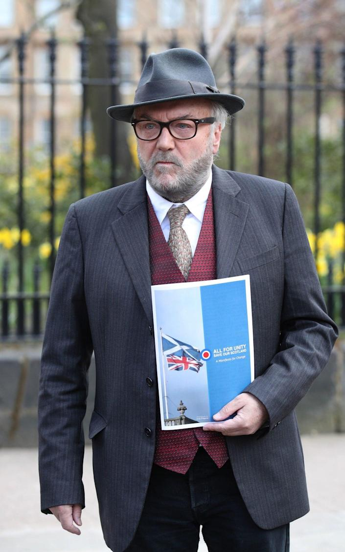 George Galloway with his manifesto - Andrew Milligan/PA