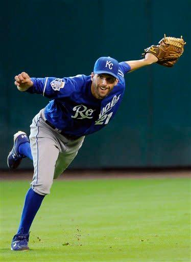 Kansas City Royals' Jeff Francoeur follows through on an off-balance throw to first base giving Houston Astros' Carlos Lee a single in the eighth inning of a baseball game on Wednesday, June 20, 2012, in Houston. (AP Photo/Pat Sullivan)