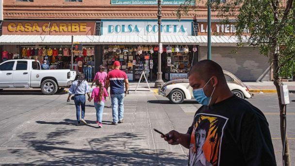 PHOTO: People wearing masks amid the Covid-19 pandemic are pictured in downtown El Paso, Texas, Oct. 24, 2020. (Paul Ratje/AFP via Getty Images)