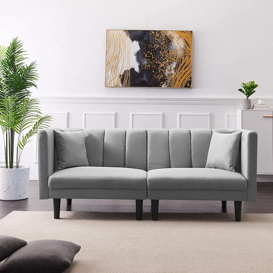 <p>This stylish <span>Convertible Futon Sofa Bed</span> ($404) is perfect for when you have guests over.</p>