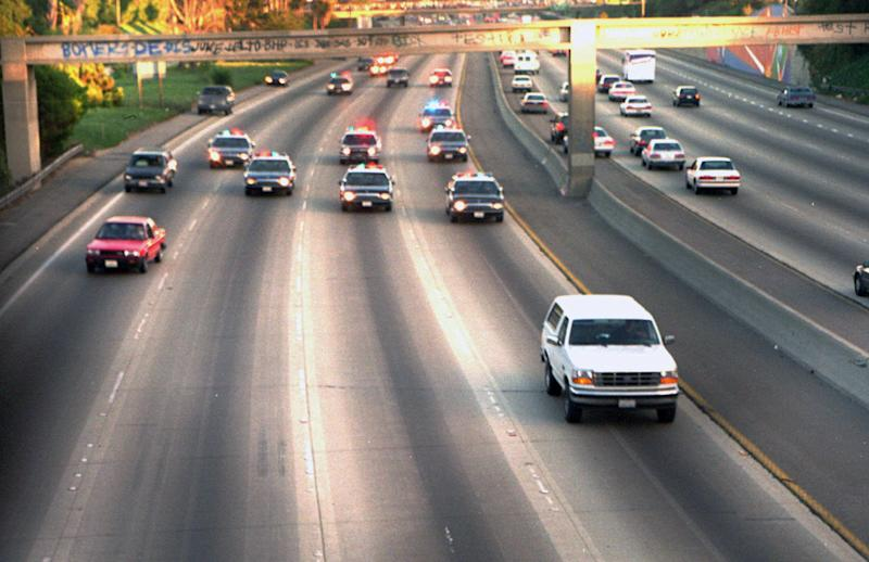 FILE - In this June 17, 1994 file photo, A white Ford Bronco, driven by Al Cowlings carrying O.J. Simpson, is trailed by Los Angeles police cars as it travels on a Southern California freeway in Los Angeles. Cowlings and Simpson led authorities on a chase after Simpson was charged with two counts of murder in the deaths of his ex-wife and her friend. The return of O.J. Simpson to a Las Vegas courtroom next Monday, May, 13, will remind Americans of a tragedy that became a national obsession and in the process changed the country's attitude toward the justice system, the media and celebrity. (AP Photo/Joseph Villarin, File)