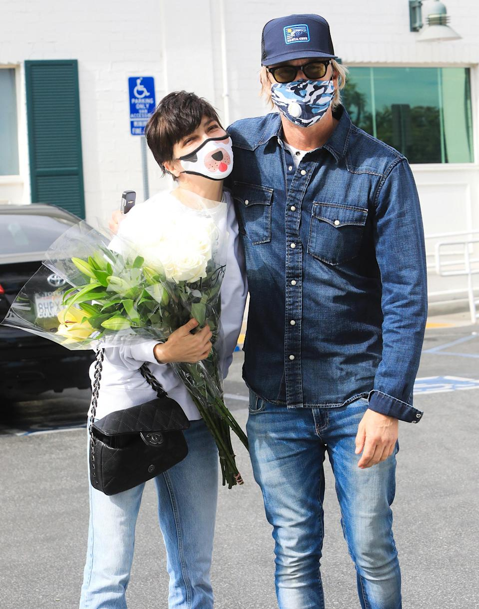 <p>Selma Blair receives a large bouquet of flowers from boyfriend Ron Carlson at Bristol Farms in L.A. on Sunday.</p>