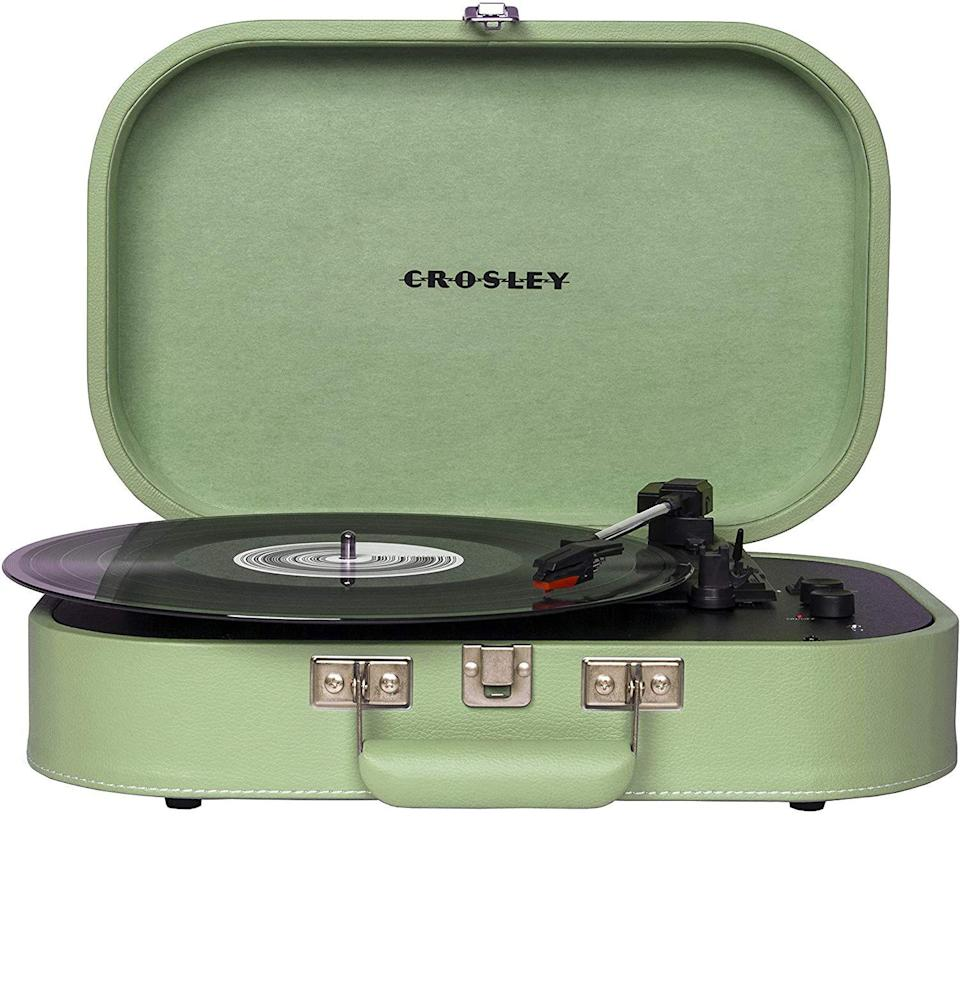 """<p><strong>Crosley</strong></p><p>amazon.com</p><p><strong>$64.95</strong></p><p><a href=""""https://www.amazon.com/dp/B07YM8S8BV?tag=syn-yahoo-20&ascsubtag=%5Bartid%7C10054.g.35269584%5Bsrc%7Cyahoo-us"""" rel=""""nofollow noopener"""" target=""""_blank"""" data-ylk=""""slk:Buy"""" class=""""link rapid-noclick-resp"""">Buy</a></p><p>Not everyone is looking for a massively complicated rig. That's where Crosley comes in. Instead of going for the intensive turntable setup with exterior speakers, this novelty briefcase with a record player inside has a built-in speaker to get you listening quickly. Conveniently, you still have the Bluetooth capability option, too.</p><p>Crosley's built-in speakers are just fine, but the <strong>vintage</strong> design goes further to set a mood. Available in five colorways (fine, we prefer green), the Discovery is a bit <strong>fancier</strong> than the Victrola before it. It also has the brand recognition in audio (and home décor) circles.</p>"""
