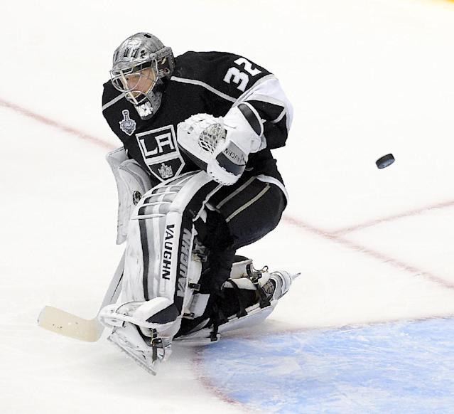 Los Angeles Kings goalie Jonathan Quick blocks a shot by the New York Rangers during the third period in Game 1 of the NHL hockey Stanley Cup Finals, Wednesday, June 4, 2014, in Los Angeles. (AP Photo/Mark J. Terrill)