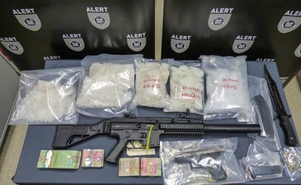 Police seized firearms, drugs and cash during the recent search of a north Edmonton home. (Submitted by Alberta Law Enforcement Response Teams - image credit)