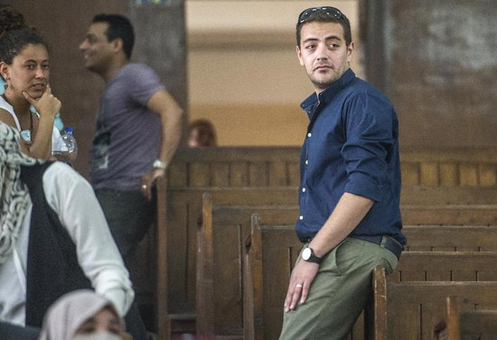 Al-Jazeera journalist Baher Mohamed (R) attends his trial at the Torah prison in Cairo on August 2, 2015 (AFP Photo/Khaled Desouki)
