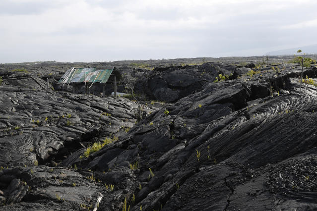 <p>A structure is seen atop the 1990 lava flow from Kilauea, one of the world's most active volcanoes, Sunday, May 6, 2018, in Kalapana, Hawaii. (Photo: Marco Garcia/AP) </p>