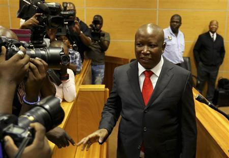 Malema, current leader of the EFF political party, gestures at Polokwane High Court