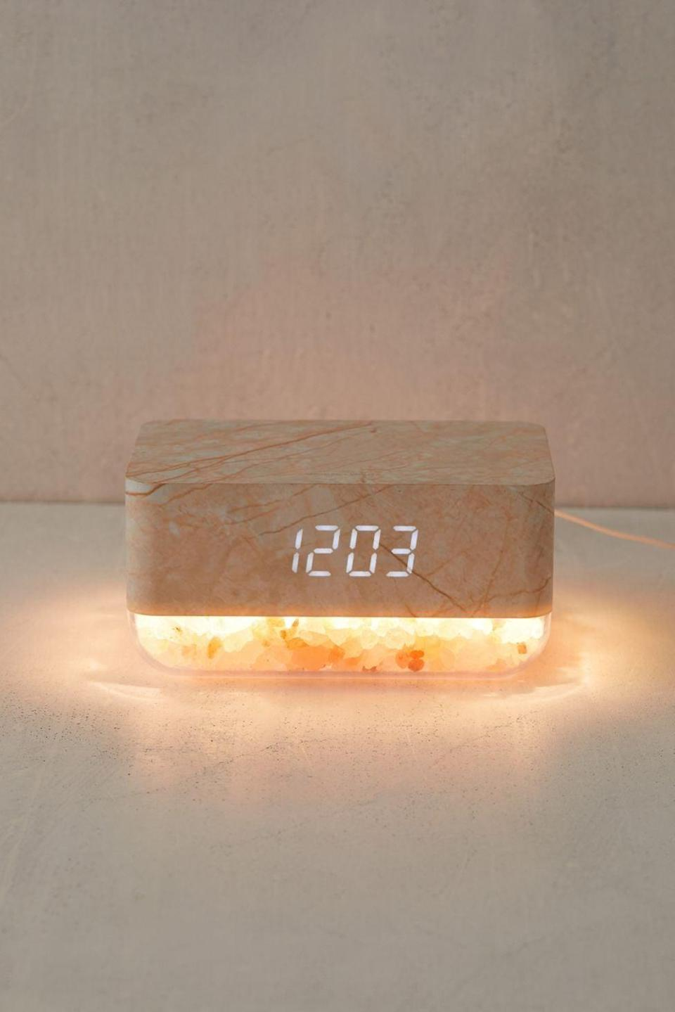 <p>Make their mornings more positive and uplifiting with this stunning <span>Mahli Himalayan Salt Sunrise Alarm Clock</span> ($38). The clock shows the time and temperature, and has a snooze function. It comes in three colors including white marble, black and grey marble, and a wooden texture. </p>