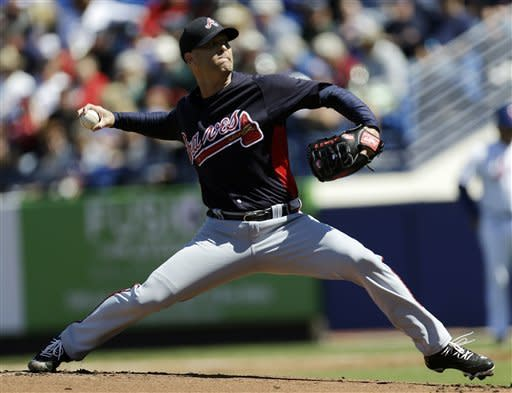 Atlanta Braves pitcher Tim Hudson throws against the New York Mets during the first inning of an exhibition spring training baseball game, Monday, March 4, 2013, in Port St. Lucie, Fla. (AP Photo/Julio Cortez)