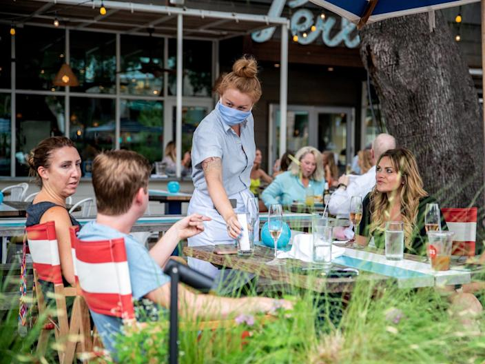 People dining out in Austin, Texas, on June 28.