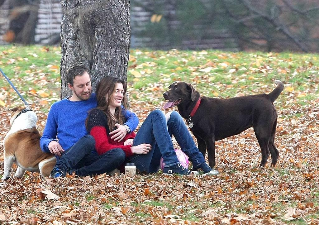 The newly engaged Anne Hathaway, her fiance Adam Shulman, and her chocolate lab Esmeralda relaxed in Fort Greene Park in Brooklyn, New York, on Sunday. The couple began dating in late 2008. (11/27/2011)