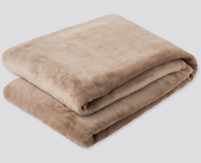 """<h2><a href=""""https://www.uniqlo.com/us/en/heattech-full-size-blanket-online-exclusive-428978.html?dwvar_428978_color=COL04"""" rel=""""nofollow noopener"""" target=""""_blank"""" data-ylk=""""slk:Uniqlo Heattech Full-Size Blanket"""" class=""""link rapid-noclick-resp"""">Uniqlo Heattech Full-Size Blanket<br></a></h2><br>As if this blanket doesn't already scream <em>snuggle up</em> — it also has moisture-absorbing, bio-warming, and insulating features to retain as much heat as possible, making it a real treat (especially when winter rolls around again).<br><br><br><strong>Uniqlo</strong> Heattech Full-Size Blanket, $, available at <a href=""""https://go.skimresources.com/?id=30283X879131&url=https%3A%2F%2Fwww.uniqlo.com%2Fus%2Fen%2Fheattech-full-size-blanket-online-exclusive-428978.html%3Fdwvar_428978_color%3DCOL04"""" rel=""""nofollow noopener"""" target=""""_blank"""" data-ylk=""""slk:Uniqlo"""" class=""""link rapid-noclick-resp"""">Uniqlo</a>"""