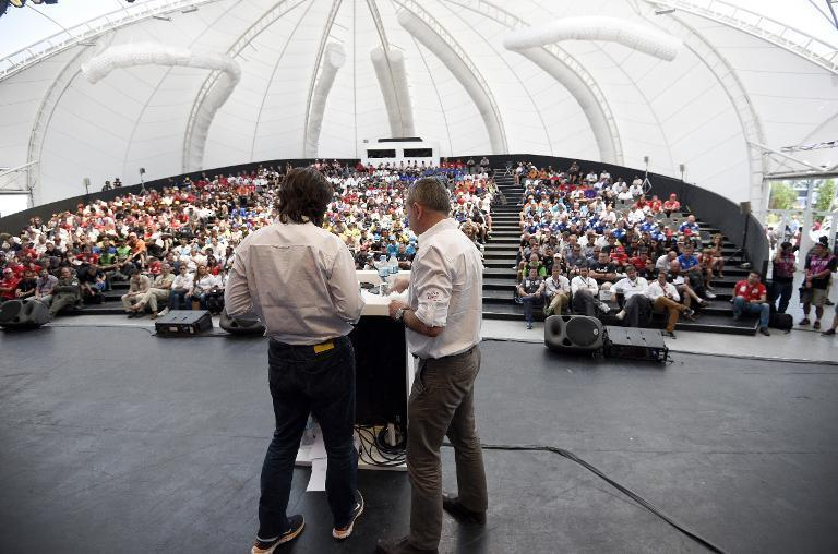 Dakar Rally director Etienne Lavigne (R) and sport director, French David Castera, get ready to give a briefing in Buenos Aires on January 3, 2015 hours before the symbolic start of the competition in the Argentine capital