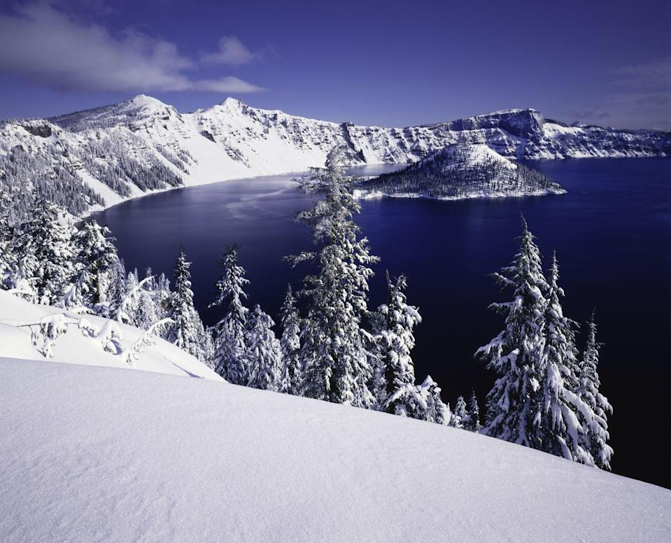 <p>Fresh snow on the rim of Crater Lake National Park, famous for its deep blue, clear water.</p>