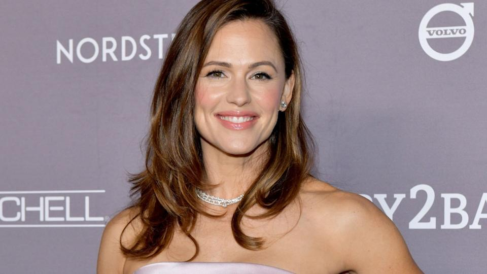 Jennifer Garner wore a pair of cheerful rainbow sneakers by Soludos. Image via Getty Images.