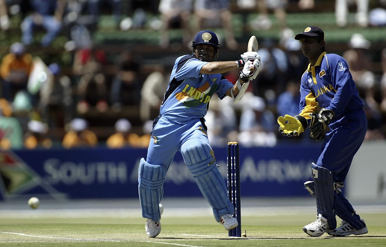 JOHANNESBURG - MARCH 10:  Sachin Tendulkar of India hits out during the ICC Cricket World Cup 2003 Super Sixes match between Sri Lanka and India held on March 10, 2003 at The Wanderers, in Johannesburg, South Africa. India won the match by 183 runs. (Photo by Michael Steele/Getty Images)