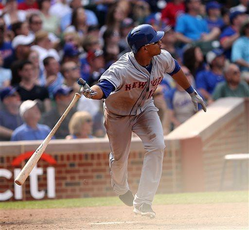New York Mets' Juan Lagares hits a two-run home run seventh inning to give the Mets a 3-3 tie with the Chicago Cubs in a baseball game in Chicago on Sunday, May 19, 2013. (AP Photo/Charles Cherney)