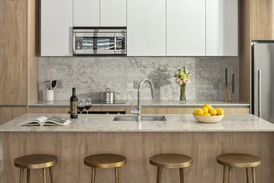 This photo shows a kitchen in a model unit at Heron, the first residential rental building in the highly anticipated Water Street Tampa neighborhood. Residence features include Caesarstone quartz counters, custom European cabinetry and state-of-the-art kitchen appliances by Fisher & Paykel.