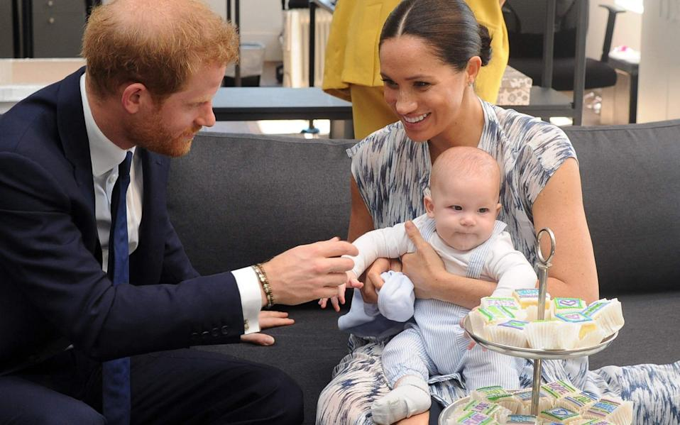 The Duke and Duchess of Sussex hold their baby son Archie in 2019 - Henk Kruger/AFP