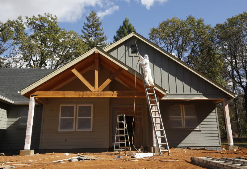 In this photo taken Thursday, Oct. 17, 2019, a home under construction is painted in Paradise, Calif. Only a handful of homes have been rebuilt in the community that lost nearly 9,000 residences in last year's Camp Fire. (AP Photo/Rich Pedroncelli)