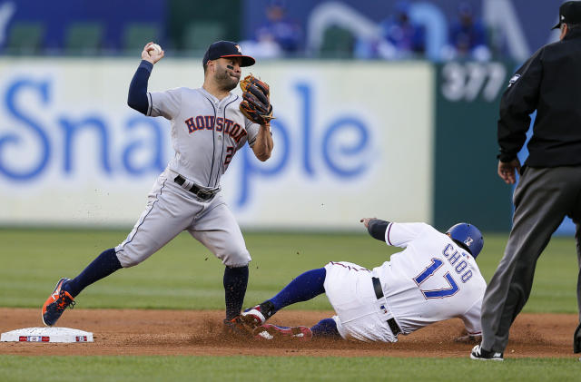 Houston Astros second baseman Jose Altuve (27) attempts to turn a double play after forcing out Texas Rangers' Shin-Soo Choo (17) during the first inning of a baseball game Friday, April 19, 2019, in Arlington, Texas. Altuve was unable to make the throw in time on Elvis Andrus. (AP Photo/Brandon Wade)
