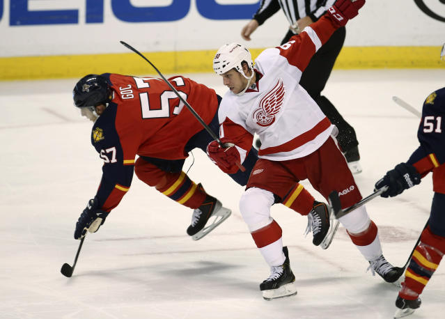 Florida Panthers' Marcel Goc (57) breaks free from Detroit Red Wings' Stephen Weiss as they chase the puck during the first period of a NHL hockey game in Sunrise, Fla., Tuesday, Dec. 10, 2013. (AP Photo/J Pat Carter)