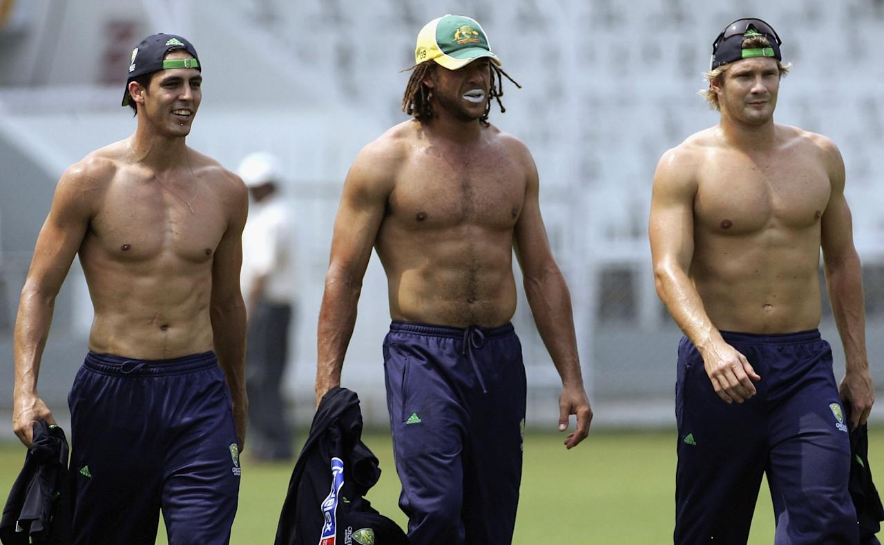 MUMBAI, INDIA - OCTOBER 11:  (L-R) Mitchell Johnson, Andrew Symonds and Shane Watson of Australia look on during training at Brabourne Stadium on October 11, 2006, in Mumbai, India.  (Photo by Hamish Blair/Getty Images)