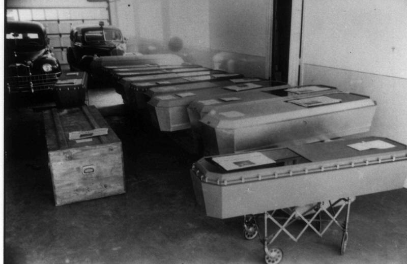 Caskets containing the bodies of Mann Gulch fire victims await shipment home to families in this August 1949 photo. The fire Aug. 5, 1949 near Helena, Mont., took the lives of 12 smokejumpers and a forest ranger. (AP Photo/Courtesy USDA Forest Service)