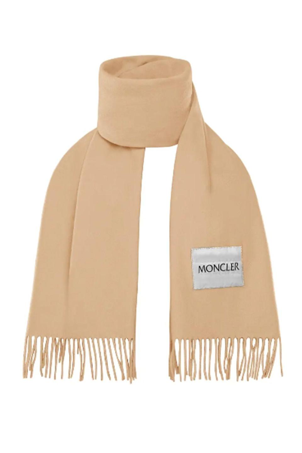 """<p><strong>Moncler</strong></p><p>nordstrom.com</p><p><strong>$280.00</strong></p><p><a href=""""https://go.redirectingat.com?id=74968X1596630&url=https%3A%2F%2Fwww.nordstrom.com%2Fs%2Fmoncler-logo-patch-fringe-wool-scarf%2F5614871&sref=https%3A%2F%2Fwww.townandcountrymag.com%2Fstyle%2Ffashion-trends%2Fg28589058%2Fbest-fall-scarves%2F"""" rel=""""nofollow noopener"""" target=""""_blank"""" data-ylk=""""slk:Shop Now"""" class=""""link rapid-noclick-resp"""">Shop Now</a></p><p>A classic camel hue will never, <em>ever </em>go out of style. </p>"""