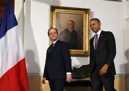 U.S. President Barack Obama (R) and French President Francois Hollande walk out to make remarks to the press after touring the Virginia residence of Thomas Jefferson at Monticello in Charlottesville, February 10, 2014. Jefferson was one of the United States' earliest envoys to France. REUTERS/Larry Downing