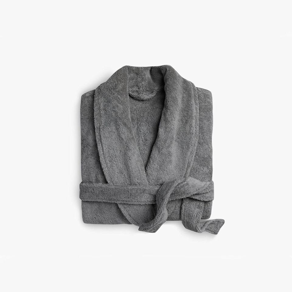 """$99, Parachute. <a href=""""https://www.parachutehome.com/products/classic-bathrobe?opt-color=stone"""">Get it now!</a>"""