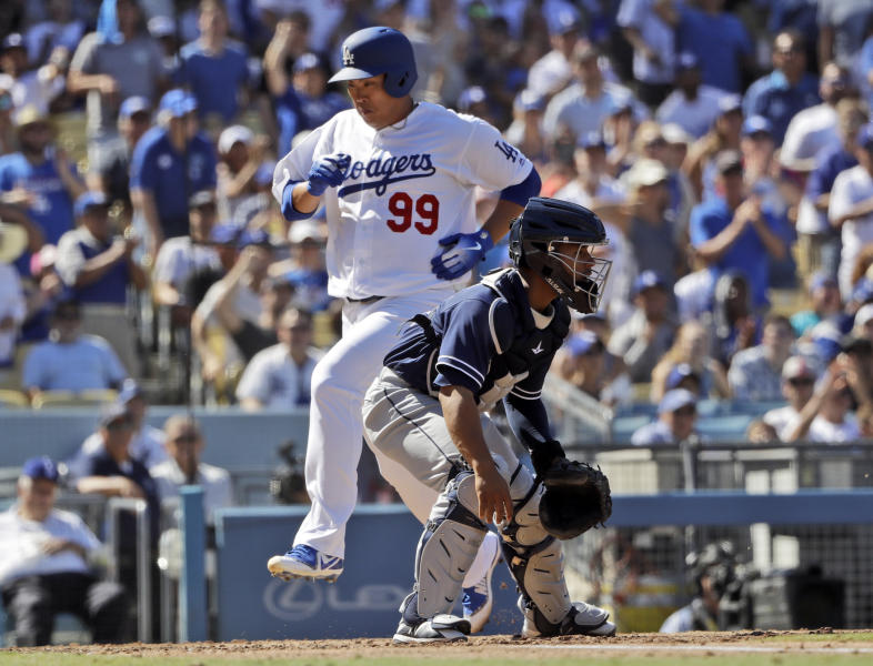 Los Angeles Dodgers' Hyun-Jin Ryu (99) scores past San Diego Padres catcher Francisco Mejia after a single from David Freese during the fourth inning of a baseball game Sunday, Sept. 23, 2018, in Los Angeles. (AP Photo/Marcio Jose Sanchez)