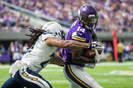 FILE PHOTO - Aug 28, 2016; Minneapolis, MN, USA; Minnesota Vikings wide receiver Stefon Diggs (14) carries the ball as San Diego Chargers cornerback Jason Verrett (22) tackles during the first quarter in a preseason game at U.S. Bank Stadium. Mandatory Credit: Brace Hemmelgarn-USA TODAY Sports / Reuters Picture Supplied by Action Images (TAGS: Sport American Football NFL) *** Local Caption *** 2016-08-28T174512Z_967942893_NOCID_RTRMADP_3_NFL-PRESEASON-SAN-DIEGO-CHARGERS-AT-MINNESOTA-VIKINGS.JPG