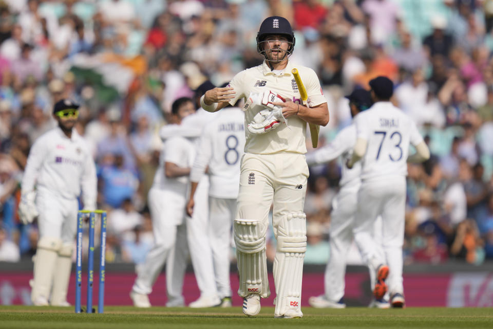 England's Rory Burns leaves the pitch after after he is caught by India's Rishabh Pant off the bowling of India's Shardul Thakur on day five of the fourth Test match at The Oval cricket ground in London, Monday, Sept. 6, 2021. (AP Photo/Kirsty Wigglesworth)