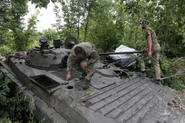 Ukrainian troops prepare for combat with Russian-backed separatists near the town of Dokuchayevsk, in Donetsk region, on July 13, 2019, as a war in the east of the country drags on