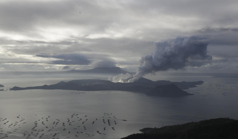 File Photo: A cloud of steam comes out of Taal Volcano as seen from Tagaytay, Cavite province, southern Philippines on Friday Jan. 17, 2020. (AP Photo/Aaron Favila)