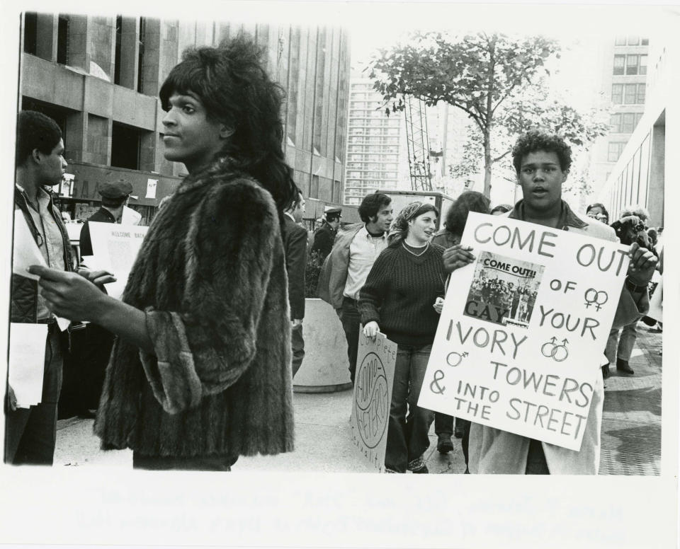 A 1970 photo of Marsha P. Johnson handing out flyers in support of gay students at NYU. (Photo: Reuters)