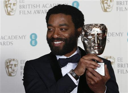 "Actor Chiwetel Ejiofor celebrates after winning Best Actor for ""12 Years a Slave"" at the British Academy of Film and Arts (BAFTA) awards ceremony at the Royal Opera House in London February 16, 2014. REUTERS/Suzanne Plunkett"