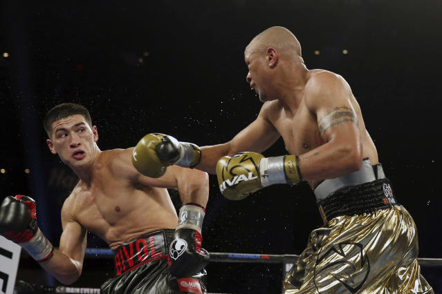 Dmitry Bivol, left, of Russia,dodges a punch by Isaac Chilemba, of Malawi, during 12th round of their light heavyweight bout Saturday, Aug. 4, 2018, in Atlantic City, N.J. Bivol won by unanimous decision. (AP Photo/Mel Evans)