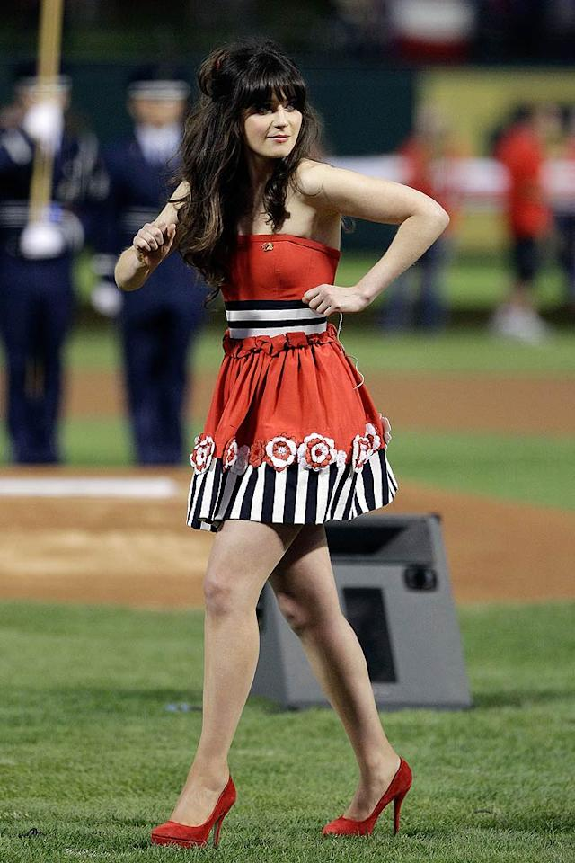 "OK, here's another polarizing ensemble for us to discuss. ""New Girl"" star Zooey Deschanel delivered a flawless rendition of ""The Star Spangled Banner"" -- before Game 4 of the World Series -- while wearing this patriotic Moschino mini. Yes, it's quirky, but so is she ... and we love 'em both. Do you? (10/23/11)"