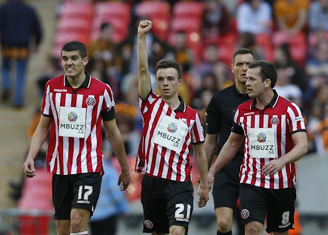 Sheffield United's Stefan Scougall, center, celebrates his goal against Hull City with teammates during their English FA Cup semifinal soccer match at Wembley Stadium in London, Sunday, April 13, 2014. (AP Photo/Sang Tan)